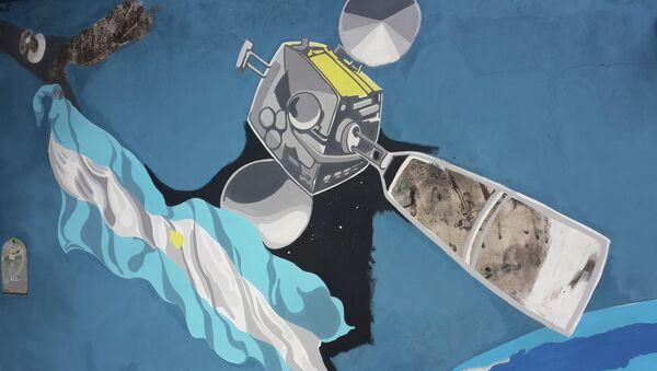 Mural pintado en Buenos Aires con motivo del lanzamiento en 2014 del satélite ARSAT-1 - Sputnik Mundo
