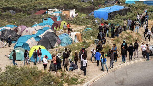 Los refugiados en Calais - Sputnik Mundo
