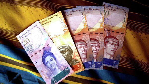 Bolívares de Venezuela - Sputnik Mundo