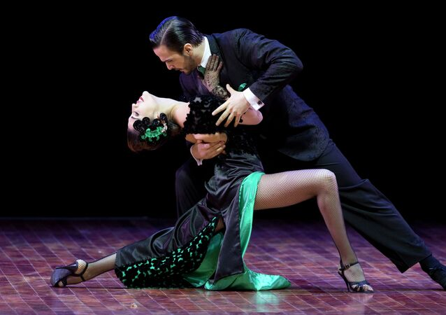 Ezequiel Lopez and Camila Alegre of Argentina compete in the stage category at the World Tango Championship final in Buenos Aires, Argentina, Thursday, Aug. 27, 2015.