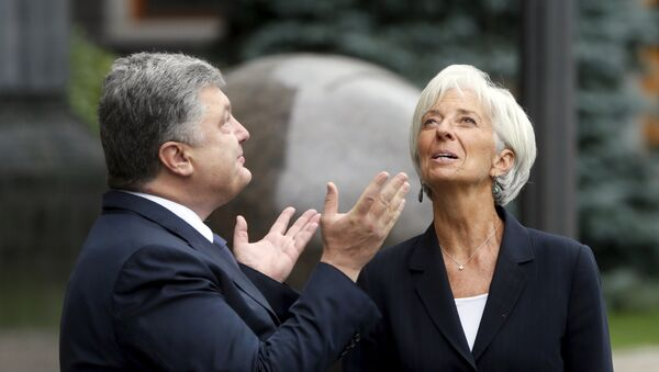 Presidente de Ucrania, Petró Poroshenko y directora del FMI, Christine Lagarde (Archivo) - Sputnik Mundo