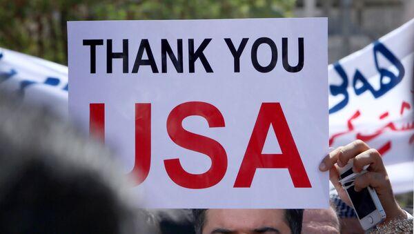 Demonstración de los cristianos de Irak delante del Consulado General de los EEUU en la capital de la región autónoma de Kurdistán - Sputnik Mundo