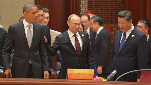 Vladímir Putin, el presidente de Rusia con sus homólogos de EEUU y China - Sputnik Mundo