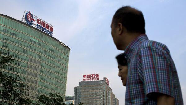 Empresas estatales principales de China, la China National Offshore Oil Corp. (CNOOC) y China Petroleum & Chemical Corp. (Sinopec) - Sputnik Mundo