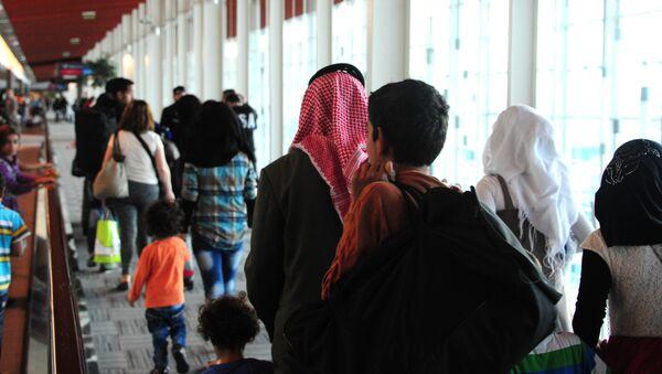 Refugiados sirios en el aeropuerto de Buenos Aires - Sputnik Mundo