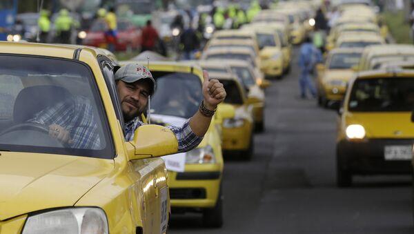 Protesta contra el servicio Uber en Bogotá, Colombia - Sputnik Mundo