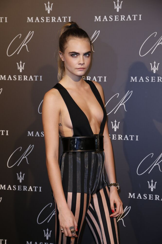 British model Cara Delevingne attends the Carine Roitfeld Party in Paris, on September 30, 2014