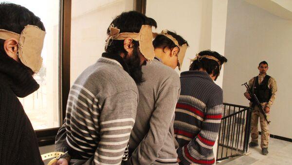 Detenidos combatientes del EI (archivo) - Sputnik Mundo