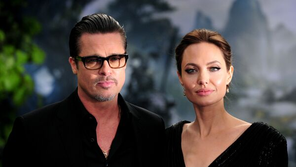 Los actores estadounidenses Brad Pitt y Angelina Jolie - Sputnik Mundo