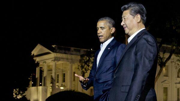 Presidente de EEUU, Barack Obama y presidente de China, Xi Jinping durante una reunión en septiembre de 2015 - Sputnik Mundo