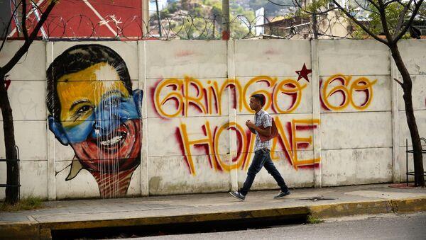 Un grafiti en Caracas - Sputnik Mundo