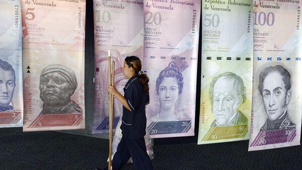 Banderas que retratan la divisa venezolana en Banco Central de Venezuela - Sputnik Mundo