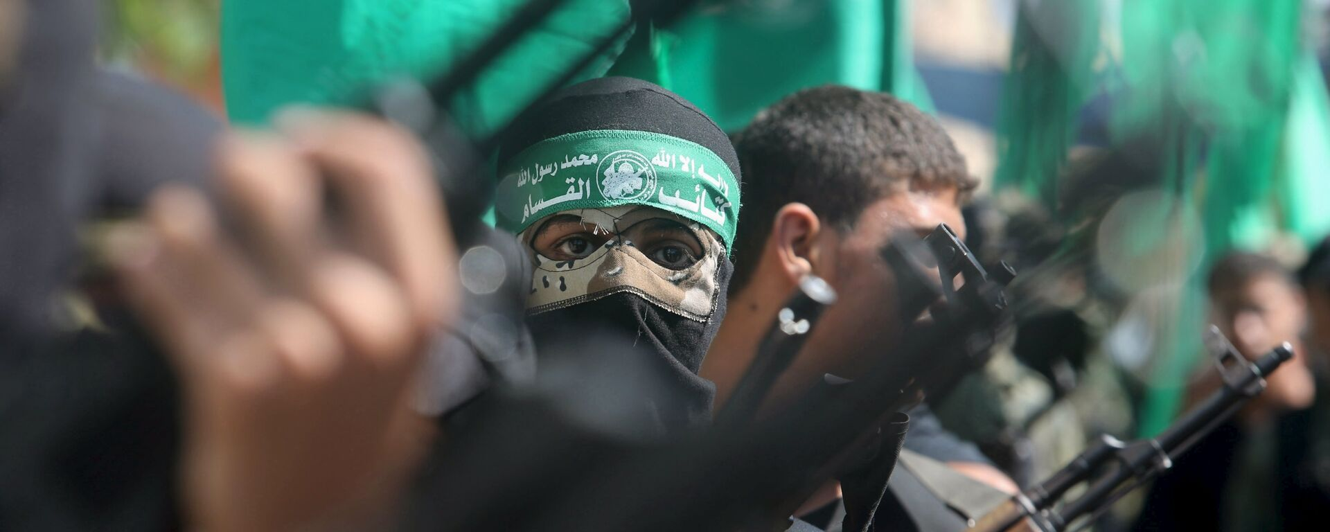 Palestinian Hamas militants take part in a protest against the Israeli police raid on Jerusalem's al-Aqsa mosque on Tuesday, in Khan Younis in the southern Gaza Strip, September 18, 2015. - Sputnik Mundo, 1920, 18.05.2021