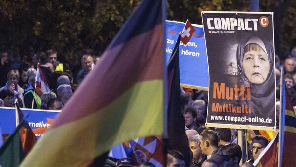 Protestas contra política migratoria alemana - Sputnik Mundo