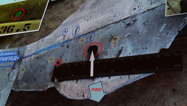 Almaz-Antey presenta el informe final de la catástrofe del MH17 en Ucrania - Sputnik Mundo