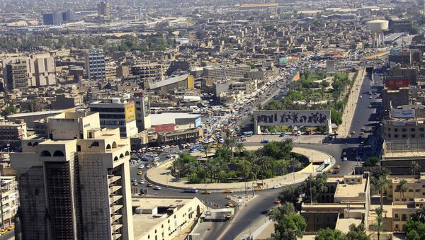 An aerial view of Tahrir Square in downtown Baghdad, Iraq, is seen Friday, Sept. 27, 2013. - Sputnik Mundo