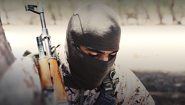 Militante del grupo terrorista Estado Islámico - Sputnik Mundo