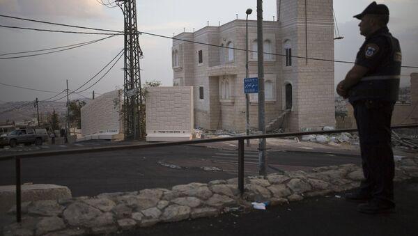Muro de hormigón en el barrio palestino de Jabel Mukaber - Sputnik Mundo