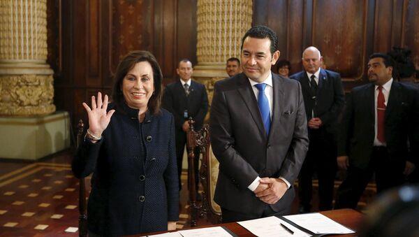 Candidatos presidenciales de Guatemala Sandra Torres y Jimmy Morales - Sputnik Mundo