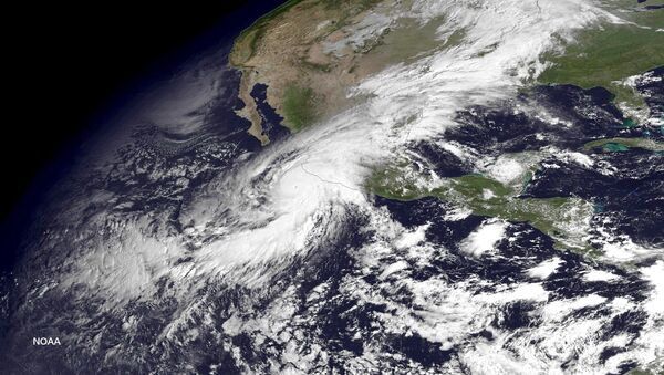 Hurricane Patricia, a category 5 storm, is seen approaching the coast of Mexico in a NOAA satellite image taken by GOES East at 10:45 ET (14:45 GMT) October 23, 2015. - Sputnik Mundo