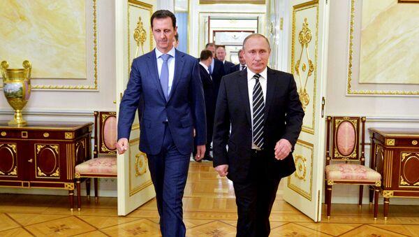 Presidente de Siria, Bashar Asad y presidente de Rusia, Vladímir Putin, durante un encuentro en el Kremlin. el 20 de octubre de 2015 - Sputnik Mundo