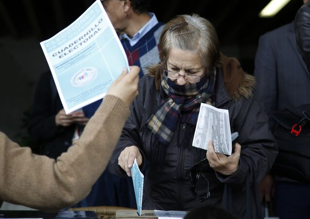A woman votes during local and regional elections in Bogota, Colombia
