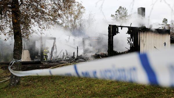 Consecuencias del incendio en un campo de refugiados en Suecia - Sputnik Mundo