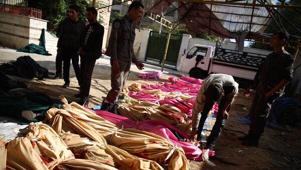 Cuerpos de las víctimas de un ataque en Damasco - Sputnik Mundo