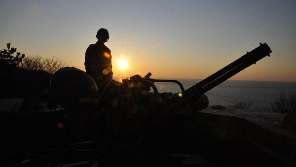 Marino surcoreano en la isla de Yeonpyeong en el mar Amarillo (archivo) - Sputnik Mundo