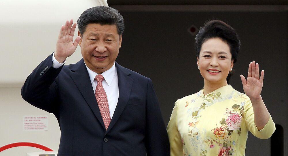 Presidente de China, Xi Jinping, y su esposa Peng Liyuan