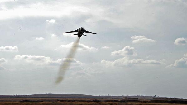 Самолет МиГ-23 сирийских ВВС на военной авиабазе Хама в Сирии - Sputnik Mundo