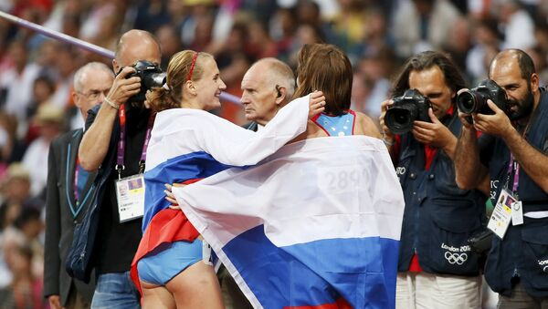 Atletas rusas María Savinova y Ekaterina Poistogova, JJOO de 2012 en Londres - Sputnik Mundo