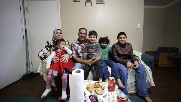 Una familia de refugiados en Texas - Sputnik Mundo