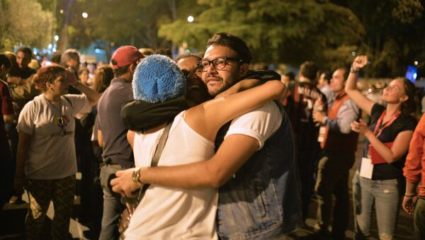 Partidarios de la oposición venezolana en Caracas - Sputnik Mundo