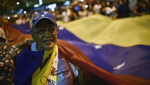 Partidario de la oposición venezolana - Sputnik Mundo