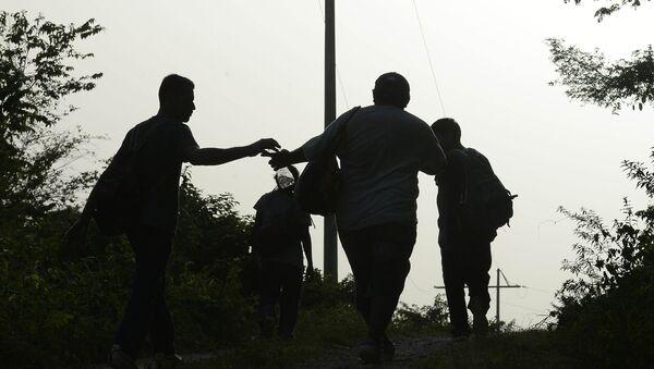 Inmigrantes ilegales en México - Sputnik Mundo