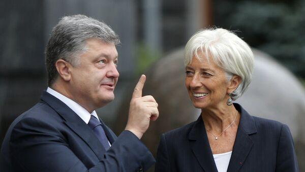 Presidente de Ucrania, Petró Poroshenko y directora del FMI, Christine Lagarde - Sputnik Mundo