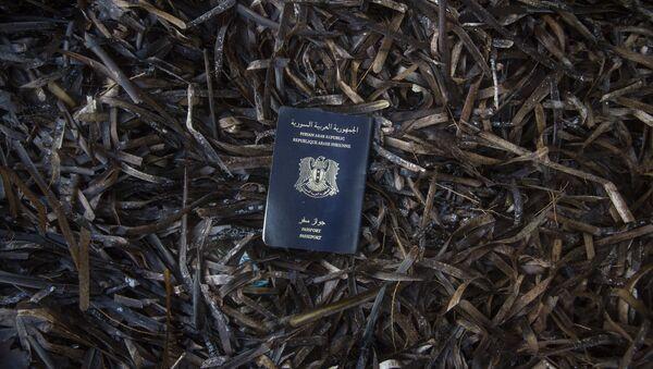 Un pasaporte sirio - Sputnik Mundo