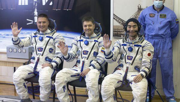 Cosmonautas Kjell Lindgren, Oleg Kononenko y Kimiya Yui (archivo) - Sputnik Mundo