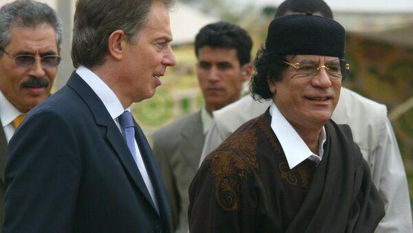 Ex primer ministro del Reino Unido, Tony Blair, y ex líder de Libia, Muammar Gadafi - Sputnik Mundo