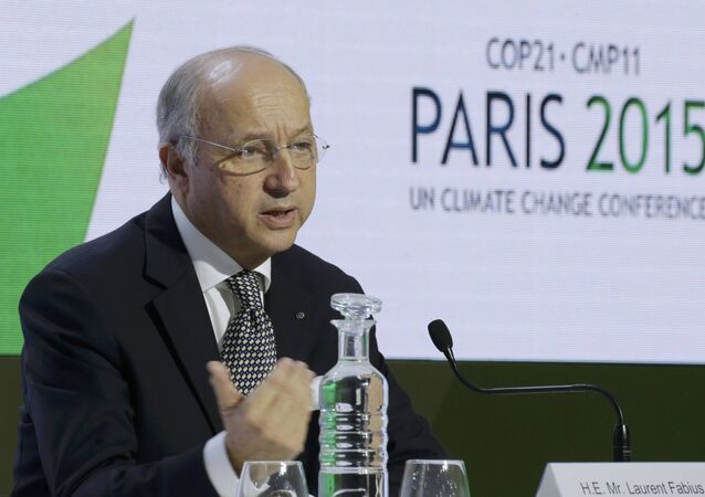 Laurent Fabius, canciller francés y el presidente de COP21