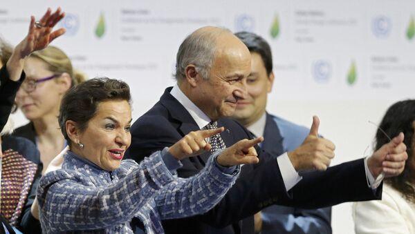 Responsable de cambio climático de la ONU, Christiana Figueres, y ministro de Asuntos de Exteriores de Francia, Laurent Fabius - Sputnik Mundo