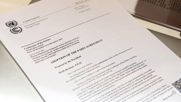 Primera página del texto del Acuerdo de París - Sputnik Mundo