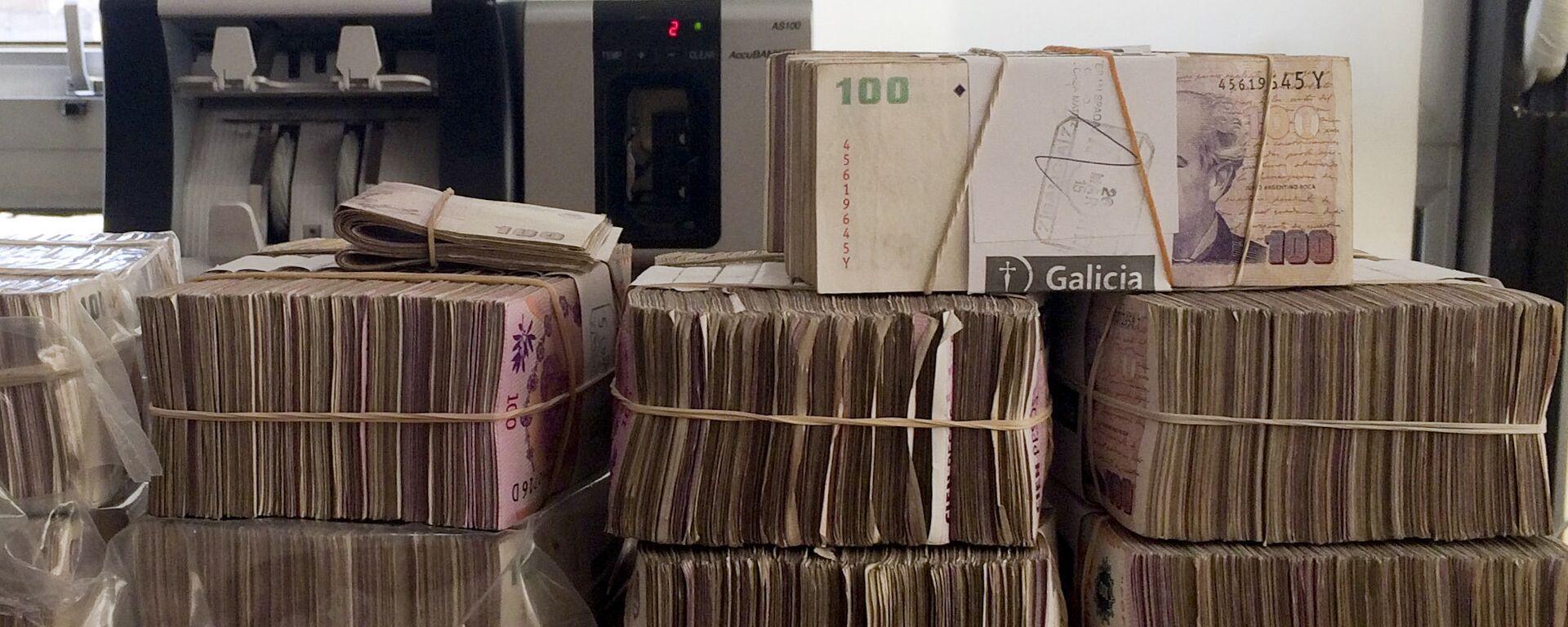 Pesos argentinos en una casa de cambios en Buenos Aires - Sputnik Mundo, 1920, 13.05.2021