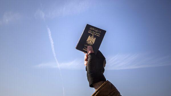 Un pasaporte iraquí - Sputnik Mundo