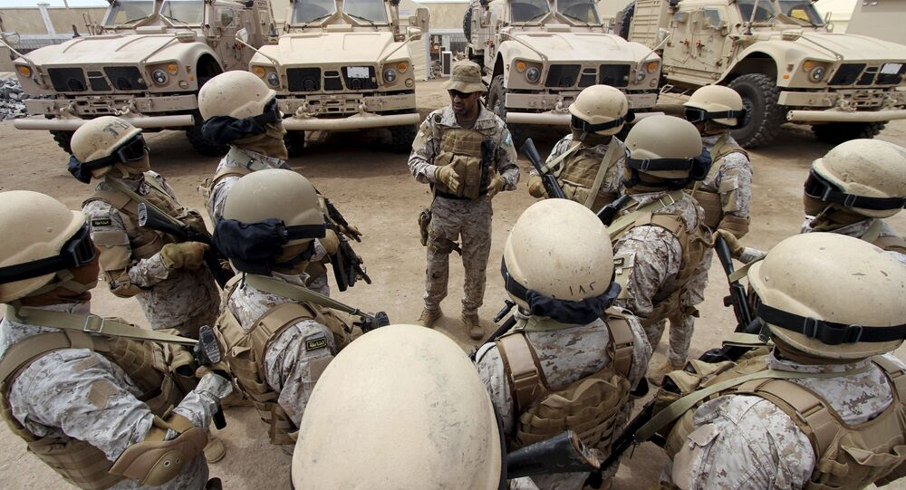 Senior army commander Abdullah al-Sahian (C), who commands the Saudi forces in Yemen's southern port city of Aden, talks to his soldiers in their base in Aden, in this September 28, 2015 file photo.