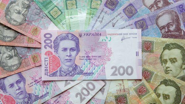 Ukrainian hryvnia banknotes are seen in a file photo illustration shot in Kiev, August 6, 2014. - Sputnik Mundo