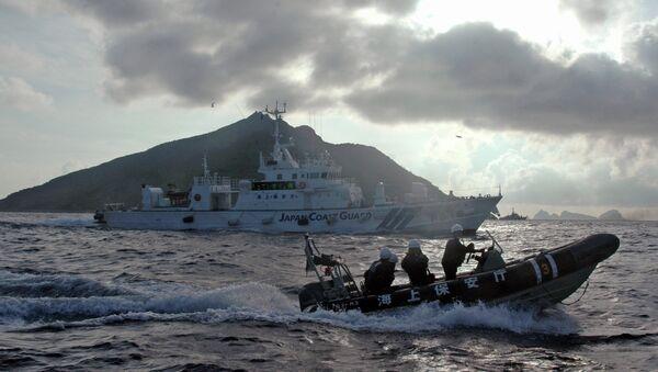 Guarda costas de Japón cerca de las islas Senkaku (Diaoyu) (archivo) - Sputnik Mundo