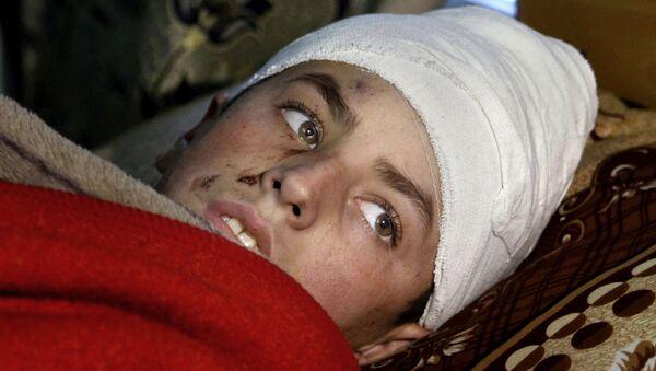 Víctima del sismo en Pakistán - Sputnik Mundo