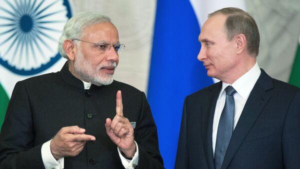 Vladímir Putin, el presidente de Rusia y el primer ministro de India, Narendra Modi - Sputnik Mundo